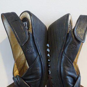 Fly London black sandals sz 38. Twist front.